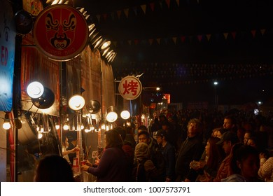 RICHMOND, VANCOUVER, CANADA - OCTOBER 2017: People queuing for food at a Chinese market stall at the Richmond Night Market.