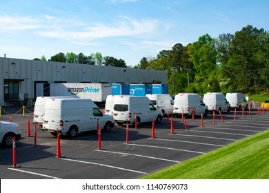 Richmond, VA/USA-May 3 2018:Delivery trucks line up outside an Amazon Prime distribution center
