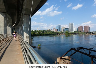 RICHMOND, VIRGINIA - August 9, 2019: The Richmond skyline is seen over the James River on a late summer day from the Belle Isle suspension bridge