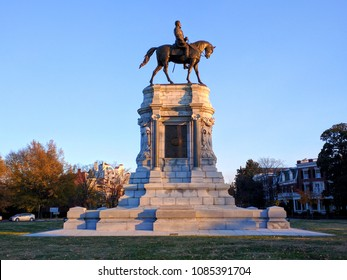 Richmond, Virginia - November 24, 2016: Sun sets before the monument of General Robert E. Lee.