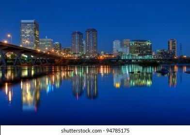 Richmond, Virginia skyline overlooking the James River at sunset.