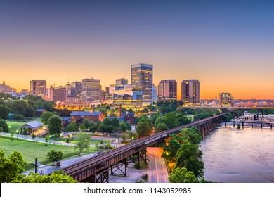 Richmond, Virginia, USA downtown skyline on the river at twilight.