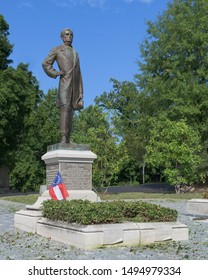 RICHMOND, VIRGINIA/USA - JULY 24, 2019: A life-size statue of Jefferson Davis marks his tomb at the historic Hollywood Cemetery in Richmond