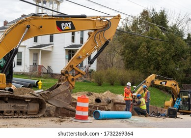 RICHMOND, VT, USA. May 6, 2020. Construction workers work on a road project wearing face coverings. Richmond, VT