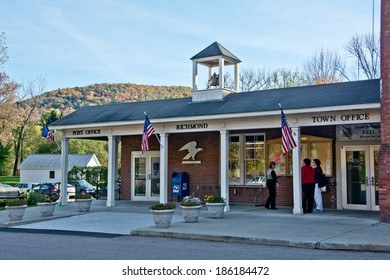 Richmond, VT, USA - October 10, 2013: Local residents pause to chat with each other outside the Richmond Town Offices on a sunny autumn afternoon.