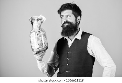 Richness and wellbeing. Security and cash money savings. Banking concept. Man bearded guy hold jar full of cash savings. Establish your budget. Financial success. Businessman with his dollar savings.