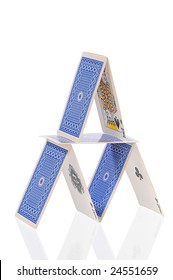 rickety structure from playing-cards on white
