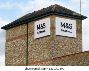 Rickmansworth, Hertfordshire, England, UK - February 12th 2019: Marks and Spencer Foodhall signs on store tower in High Street, Rickmansworth