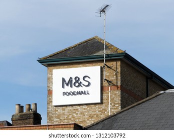Rickmansworth, Hertfordshire, England, UK - February 13th 2019: Marks and Spencer Foodhall sign on store in High Street, Rickmansworth