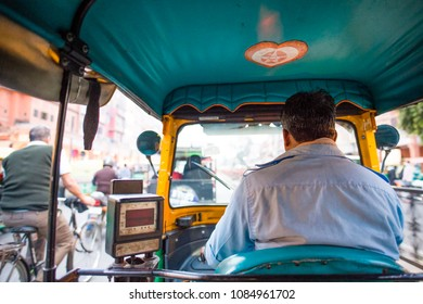A rickshaw (also known as Tuc Tuc) driver is driving in the streets of Agra in India. Agra is a city on the banks of the river Yamuna in the northern state of Uttar Pradesh