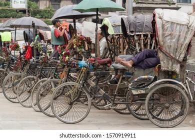 Rickshaw driver resting in Khatmandu, Nepal