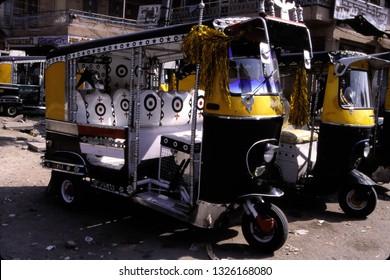 Rickshaw waiting in street in Hydrerabad, India