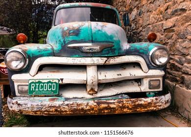 RICO COLORADO JULY 3, 2018, USA - Old Chevy Pickup truck with custom Colorado License plate saying RICOCO, Rico, Colorado