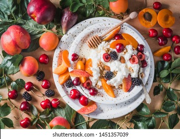 Ricotta cheese or cottage cheese with fruits, berries, honey and nuts. Italian ricotta cheese with fruits copy space directly above.