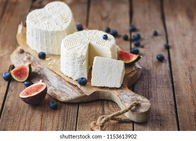 ricotta cheese on rustic cutting board over wooden table