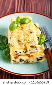 Ricotta cheese and spinach filling cannelloni on plate
