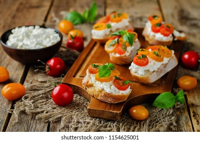 Ricotta tomato Basil bruschetta with fresh tomatoes and Basil leaves. toning. selective focus