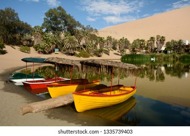 Ride boats in the Huacachina lagoon in the Ica desert