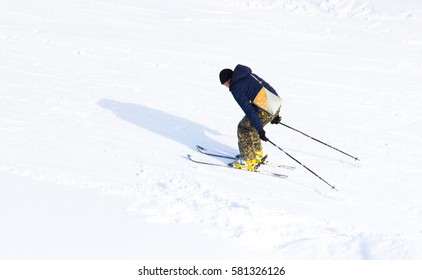 The ride from the mountain on skis, sporting events skiing.