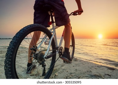 Ride on bike on the beach. Sport and active life concept