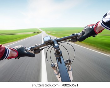 Ride on bycycle on road. Sport and active life concept