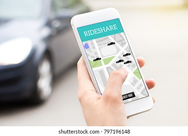 Ride share taxi service on smartphone screen. Online rideshare app and carpool mobile application. Woman holding phone with a car in the background. Person ordering ride with cellphone.