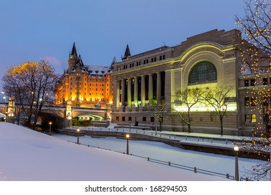 The rideau canal under the snow with the Christmas lights in Ottawa at sunset