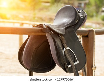 Rider horse Leather saddle on fence