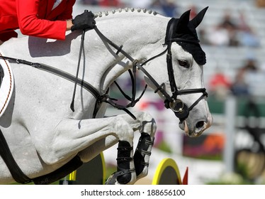 A rider jumping a horse at a horse show
