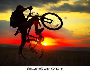 Rider on bike on sunset