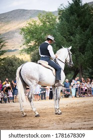 rider on his horse, performing dancing and dressage with him, in exhibition held in the town of Serranillos, Avila, Spain, on August 31, 2019