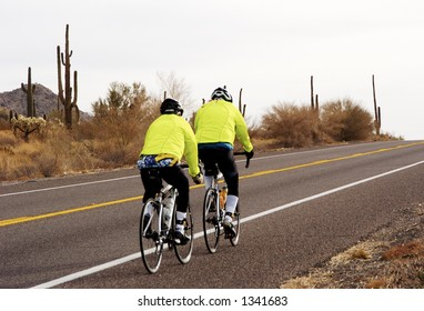 Riders in a bike race through the Arizona desert.
