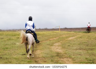 Riders completing one of the long distance stages of the enduro equestrian games
