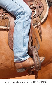 Rider's foot in stirrup in a western saddle