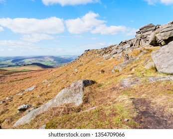 The ridge line of Higger Tor poits across the Derbyshire Peak District on a bright spring day