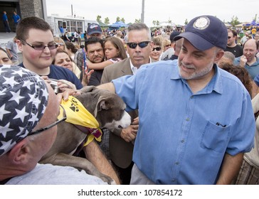 RIDGEFIELD PK, NJ-JULY 14: Famous 77 WABC radio host and dog lover Mark Levin surrounded by fans at the 2nd Annual Bark In The Park on July 14, 2012 in Ridgefield Park, NJ.
