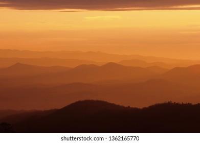 The ridges of the Appalachian mountains glow just before sunrise near Asheville, North Carolina.