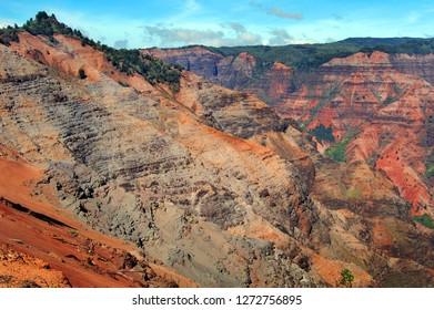 Ridges and vallies of Waimea State Park show layers of erosion by wind and rain.  Waimea Canyon State Park is on the Island of Kauai, Hawaii.