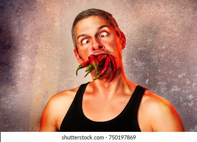 ridiculous expression of a man with hot chillies in his mouth
