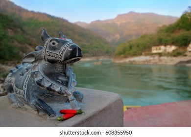 The riding animal of Lord Shiva is the bull Nandi against the backdrop of the Ganges River and the foothills of the Himalayas.Animal worship in Hinduism.