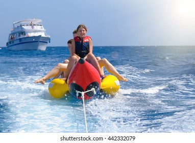 Riding banana boat.
