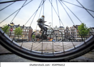 Riding a bicycle in Amsterdam, The Netherlands, Europe