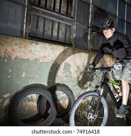 Riding bicycle in industrial environment, urban mountain biking