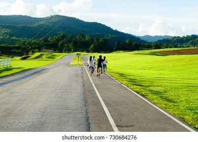 Riding bicycle at Singha Park, Thailand.