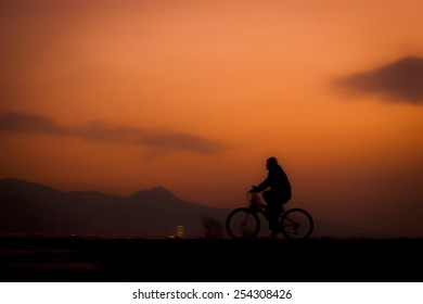 Riding bicycle at sunset.