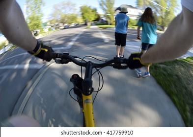 Riding Bike Fisheye View pov biking in park with kids