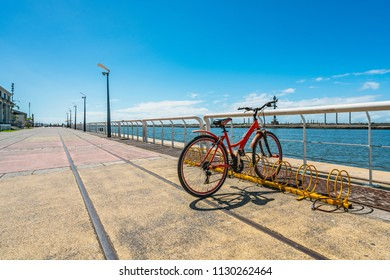 Riding a bike with a view of Capibaribe River from Ancient Recife, Pernambuco, Brazil