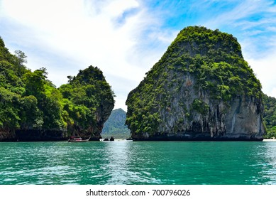 Riding in boat around the limestone mountains. Ao Nang Bay, Krabi Province, southern Thailand.