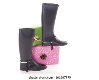 riding boots and gifts with a white background