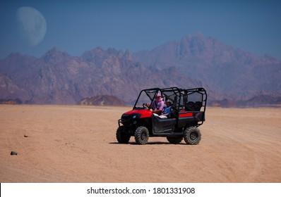 riding a buggy car through the desert. thrill tourism adventures